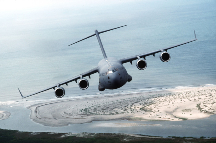 6. The view is of a C-17 aircraft banking over Charleston, SC Air Force Base.