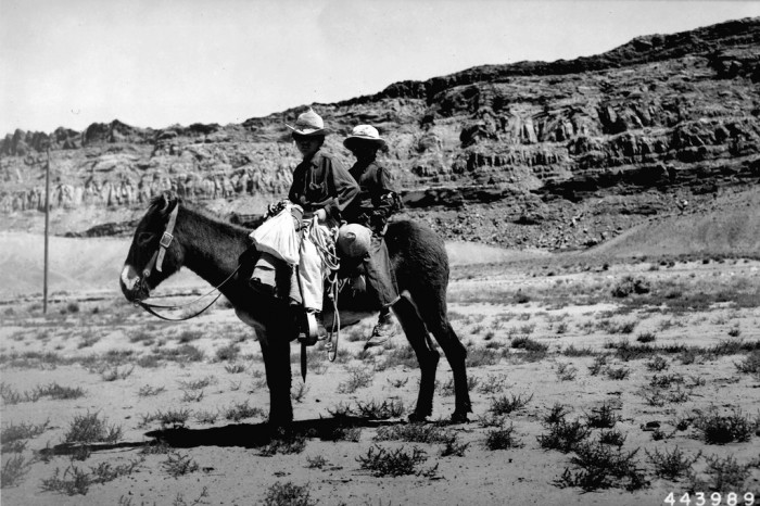 6. These two Navajo boys were herding their family's sheep with a watermelon in tow. Don't lose track of the sheep! (1946)