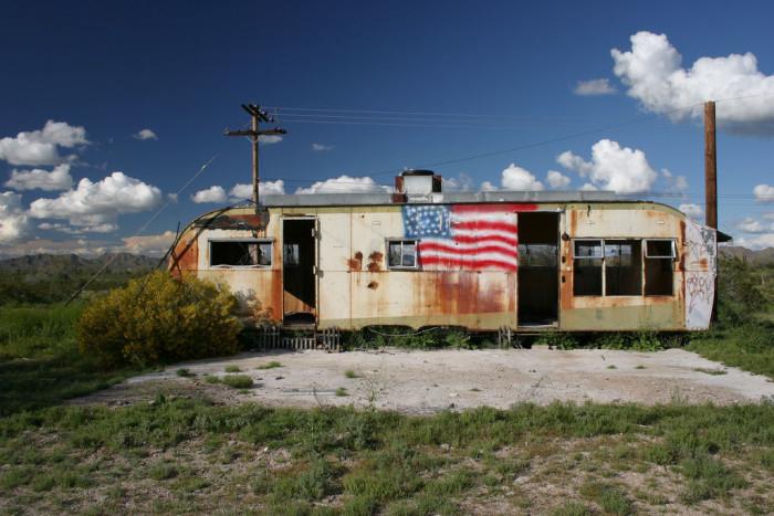 1. An abandoned trailer sits outside of Buckeye.
