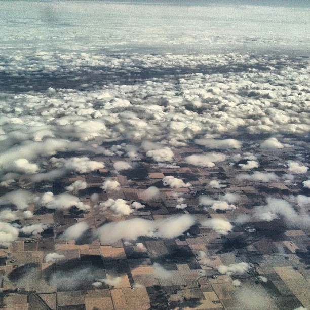 Endless Cottony Clouds Above a Grid of Farmland
