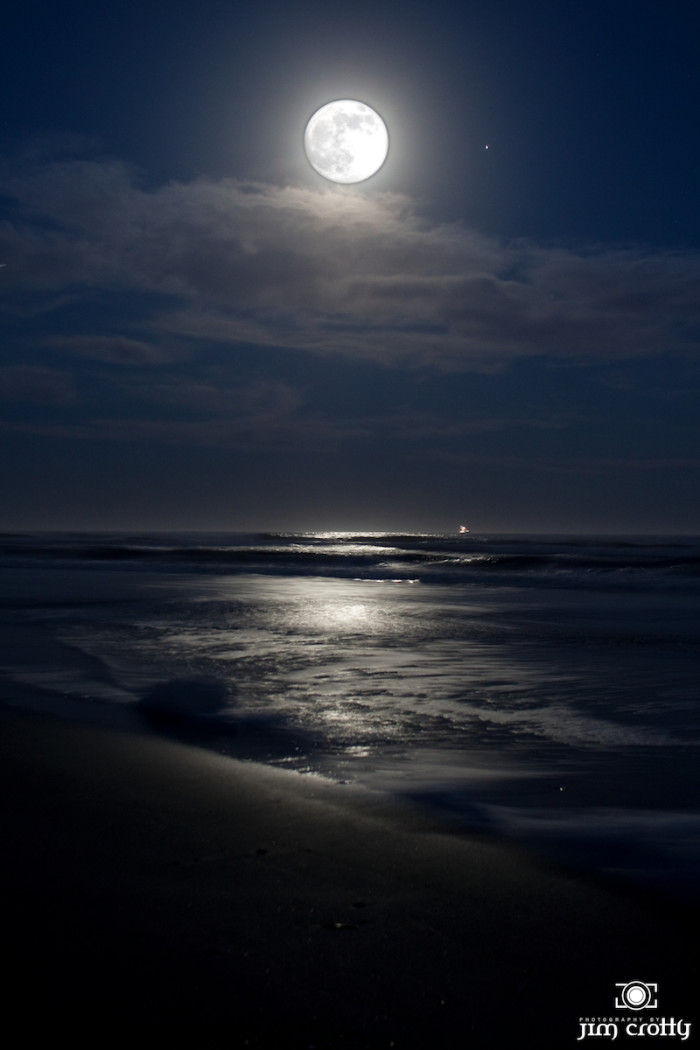 10. A beautiful picture of a full moon over the ocean, but then again, nothing good ever happens on the beach at night.