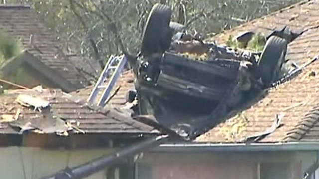 5) An SUV crashed and flipped over onto the roof of a home in Houston.
