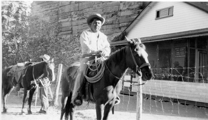 14. A Havasupai man sits on his horse in front of a building in Supai. (1948)