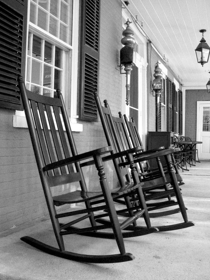 7. A porch swing and/or rocking chairs for relaxing outside after a long day's work.