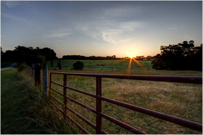 7. There is something about fences, cut hayfields, and the setting sun.
