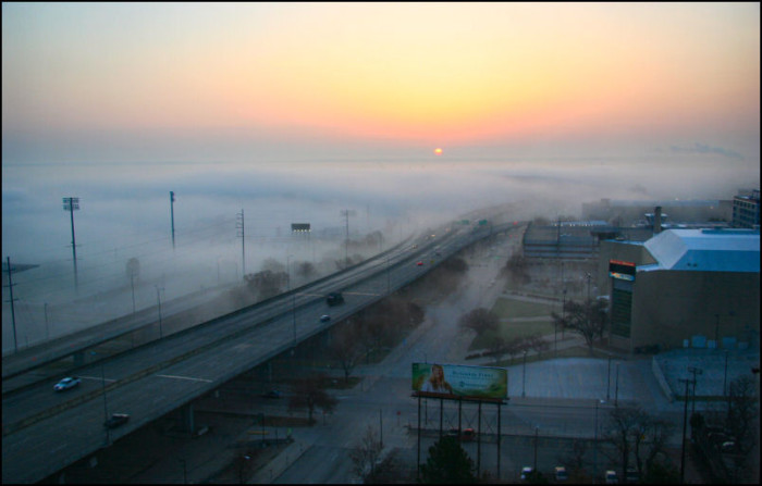 The area near Omaha's Creighton University is covered in a thick blanket of fog early in the morning.