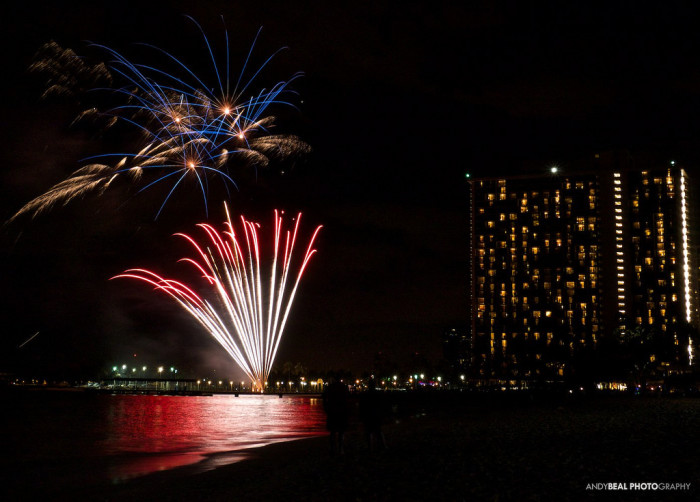 9) Kiss under the light of Waikiki's Friday night fireworks over the beach.