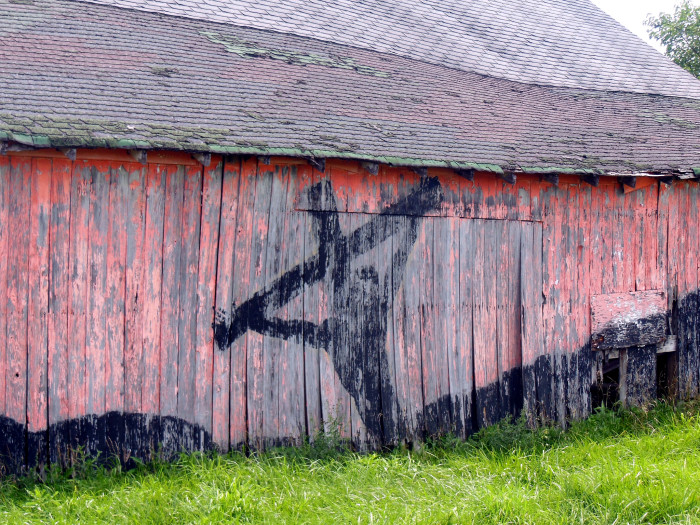 3. I'm far from being a religious person, but the side of this barn is still pretty cool! Wonder how it got there?