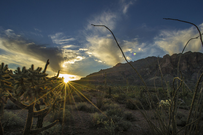 13. The sun peaks out from behind the mountains in Apache Junction.