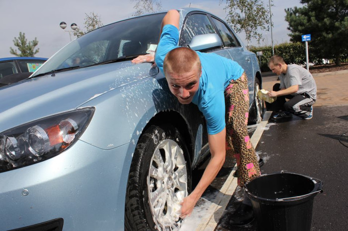 9) Grab the hose and wash your car the old-fashioned way.