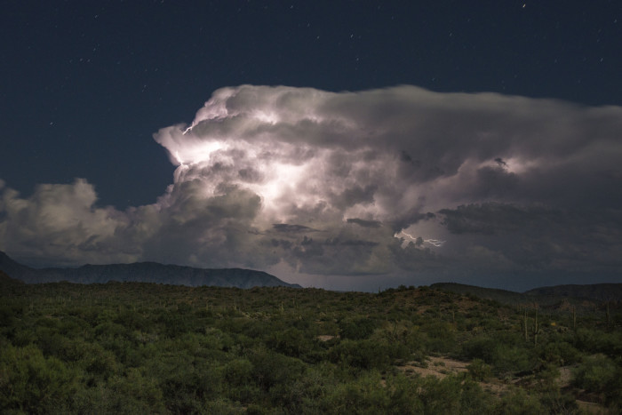 10. Wow! The slow shutter speed caught lightning and the cloud's movement over the mountains.
