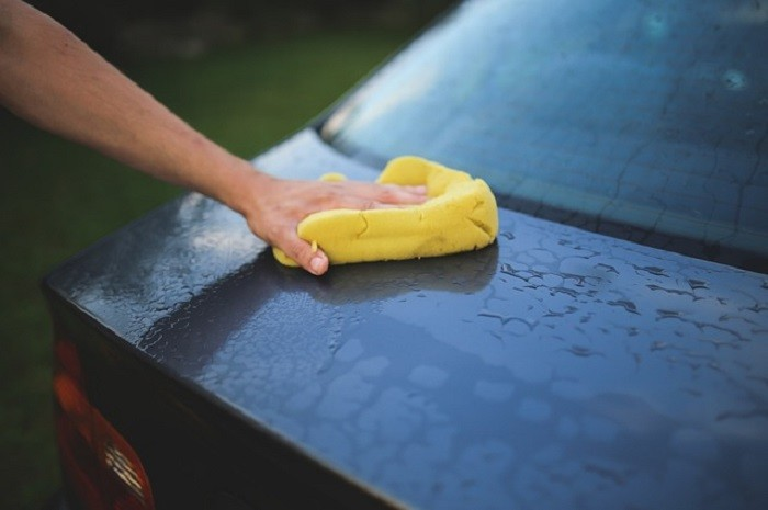 11. Grab the water hose and wash your car.