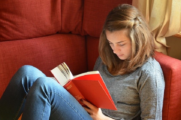 12. Stay inside and curl up with a good book.