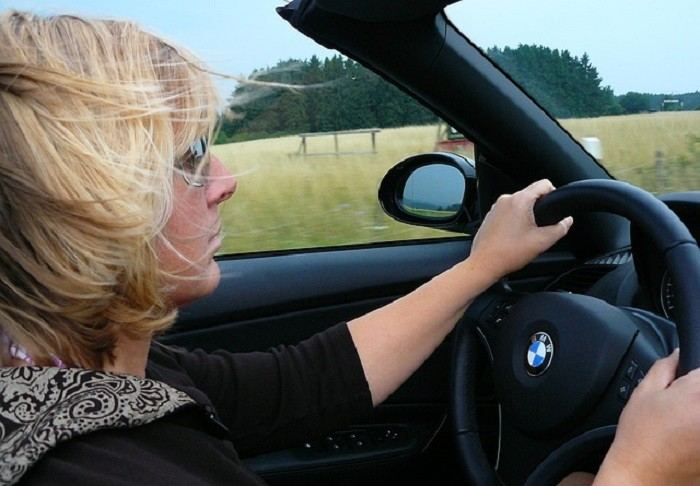 3. Rent a convertible and spend the day driving around town with the top down.