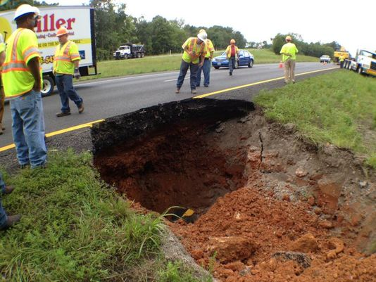 Take a look at this massive sinkhole. We're just glad it wasn't a couple feet to the side...that could've created a REAL roadblock.