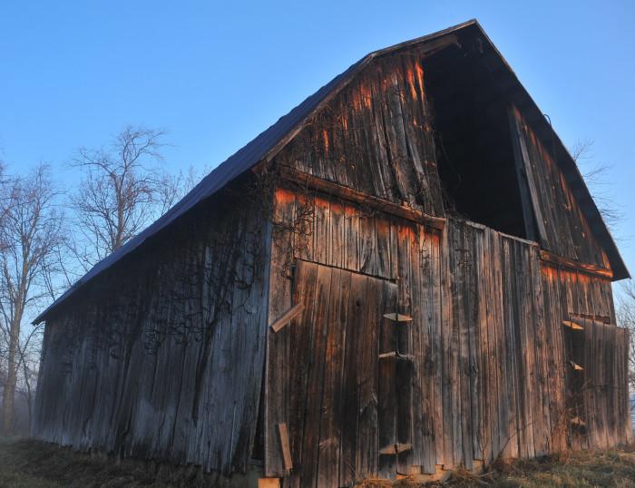 7. This old barn made of dark wood.