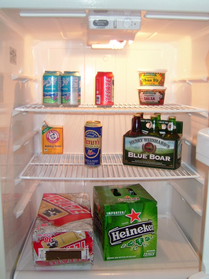 3. A fridge full of beer, often decorated with Seahawks & Mariners season schedules.