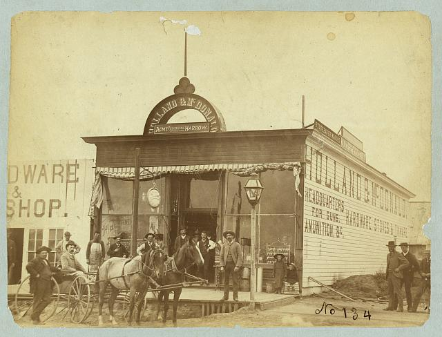 A Group Posing in Front of the Holland and McDonald Hardware Store, Broken Bow, 1886