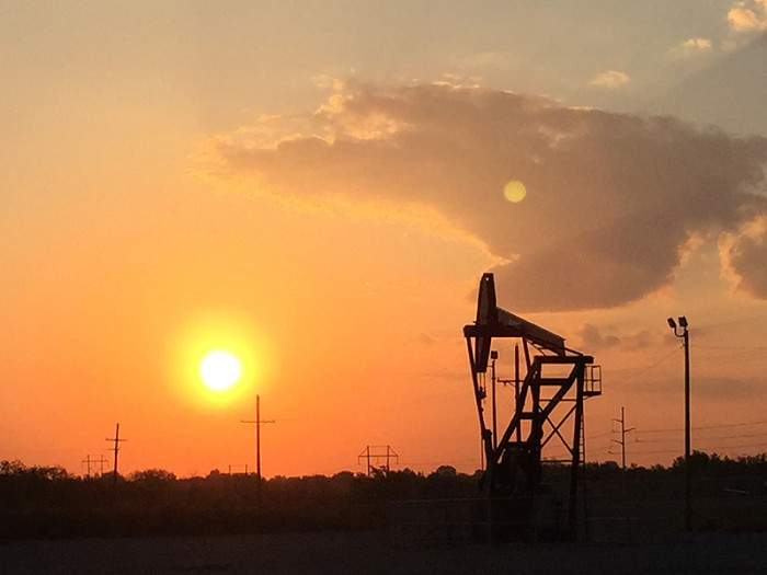 9. An oil well hard at work as a new day begins in Oklahoma City.
