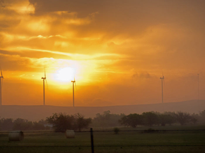 1. This stunning sunrise shines brightly on this wind farm near Apache.
