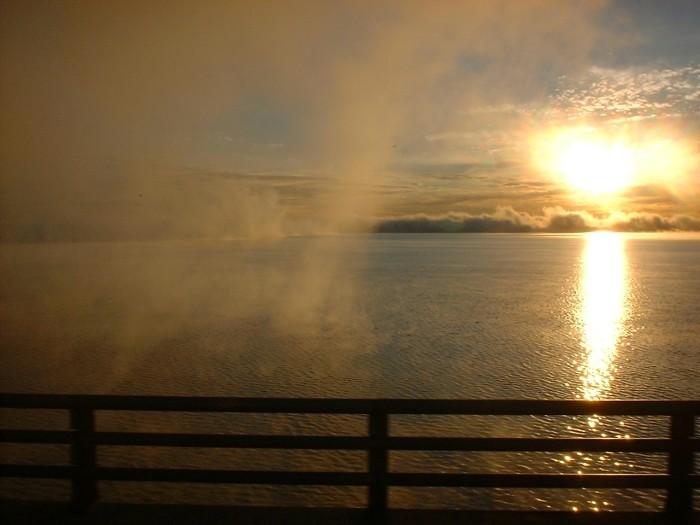 8. A beautiful sunrise on Lake Texoma with lingering fog.