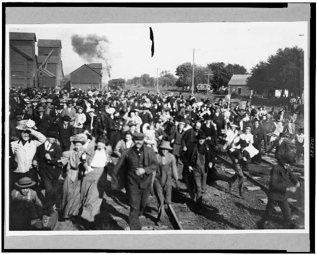 A Crowd of People Running to Meet Taft on His Campaign Tour, De Witt, 1908