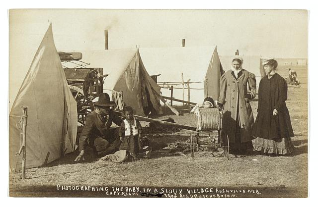 """""""Photographing the Baby in a Sioux Village,"""" Rushville, 1908"""