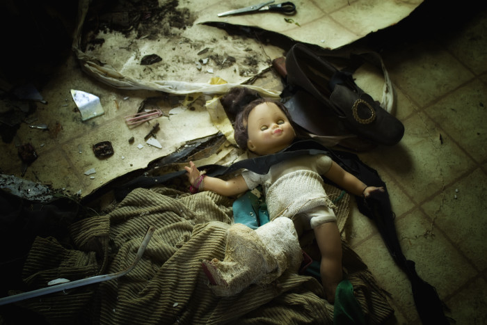 10. Somehow a typical doll takes on somewhat of an evil persona when lying among a pile of debris in an abandoned home. Almost as if you expect it to be possessed.