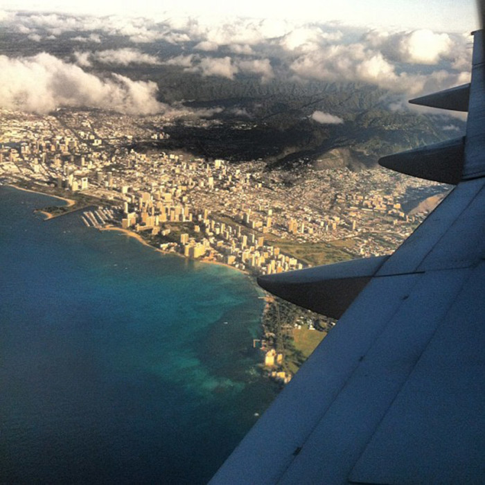 12) While this aerial photo shows us the other side of Hawaii… the tourist trap, the modern luxuries of city life.