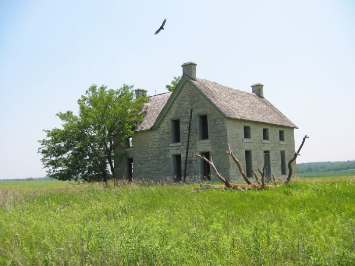 This solidly-built stone house sits in a lonely field near Nebraska City, just begging to tell its story. The buzzard flying over it in this shot from 2003 really adds to the sense of loneliness and mystery.