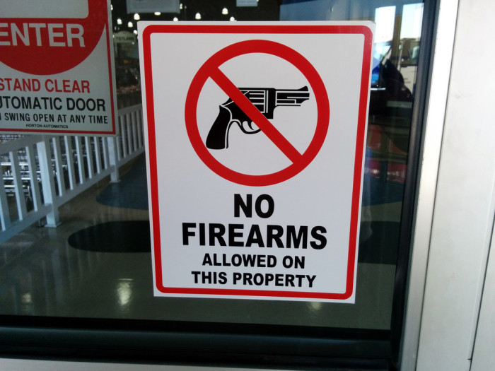 10. No guns signs in storefront windows.