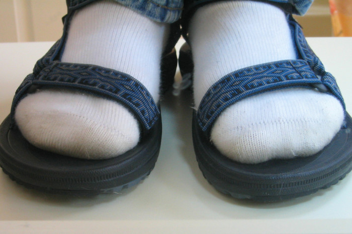 2. Wearing socks with sandals.