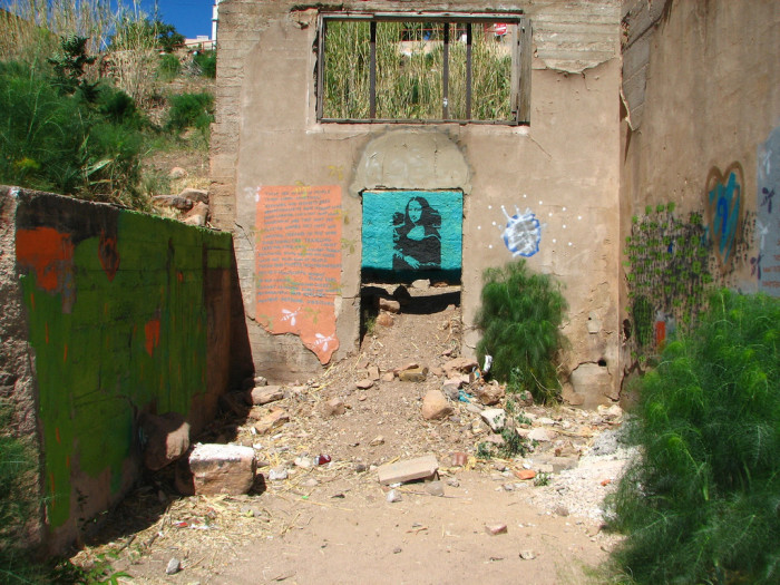 18. An image of the Mona Lisa found on an abandoned building in Bisbee.