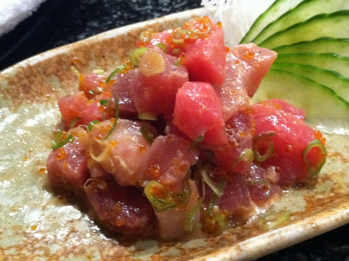 3) Poke, a raw fish salad, usually consists of cubed ahi (yellowfin tuna) marinated with sea salt, soy sauce, sesame oil, limu seaweed and chili powder.