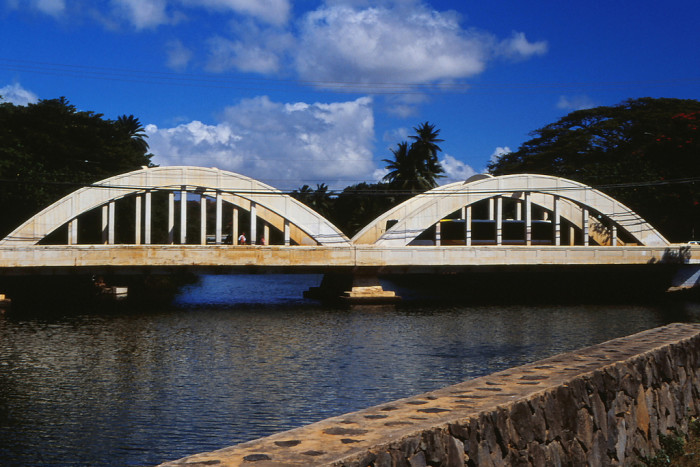 3) The Anahulu Bridge runs through the sleep town of Haleiwa, located on Oahu's north shore. The bridge floats above a canal feeding into the bay – a popular spot for SUP and kayak rentals.