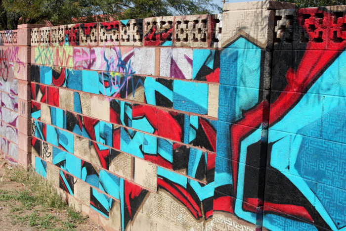 7. The alley behind the Phoenix Arizona Art Supply is covered in similar artwork. What made this one stand out was the deliberate placement of art on different blocks to make it look like the blocks were re-arranged.