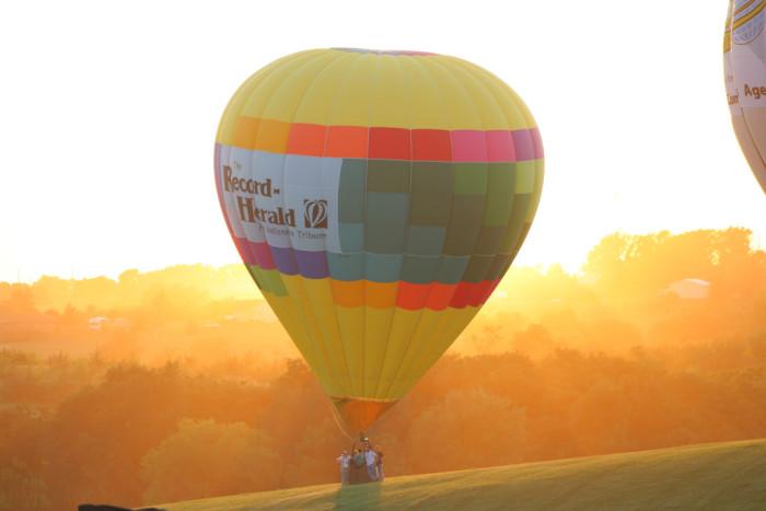 4. Soaring through the sky in a hot air balloon