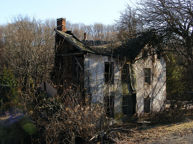 3. Haunted, or just extremely dilapidated and covered in spidery vines...?