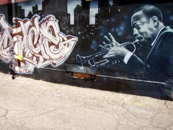 15. Perhaps this was the artist's way of saying that traditional forms of jazz and graffiti share at least one thing: improvisation.