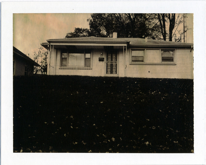 1. That fact that this is a polaroid without color just makes it that much more creepy in my opinion. This picture is of a house in South Bend.
