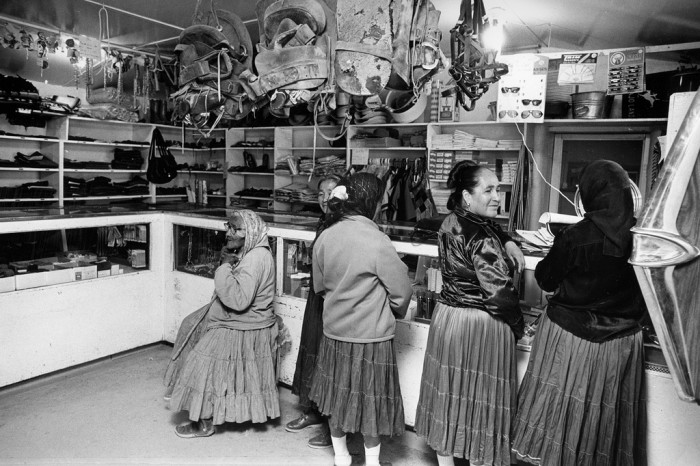 17. It wasn't that long ago that seeing old grandmas and Navajo families purchasing goods at the trading post was a common sight. This picture is from 1971 and shows women purchasing and selling items for their families.