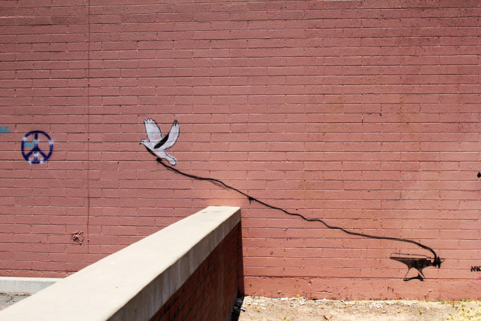 19. This artist had a bleak outlook on achieving peace. This was found in Tempe near Ash Avenue.