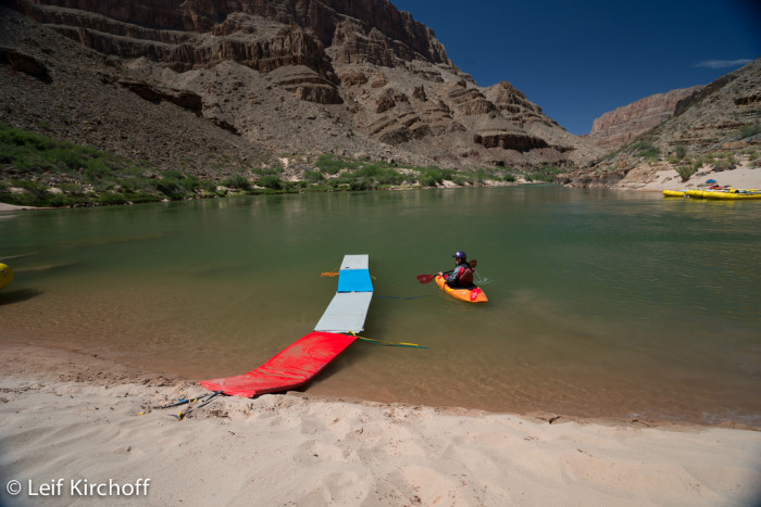 8. This kayaker at the Grand Canyon is leaving the river's beach for some fun on the water.