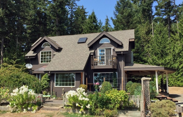 Or...you could dwell in this secluded 2-bed, 2-bath (2,020 sqft) Friday Harbor home for only $659K!