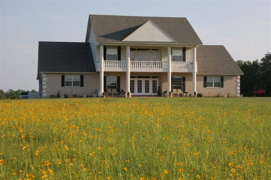 6. This 6 bedroom, 6.5 bathroom home with 5,980 square feet for $702,000