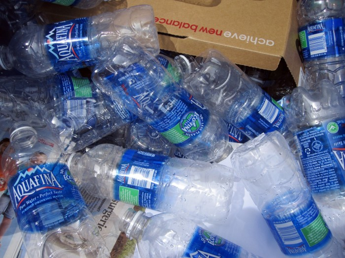 6. Throwing away a perfectly recyclable bottle in the garbage.