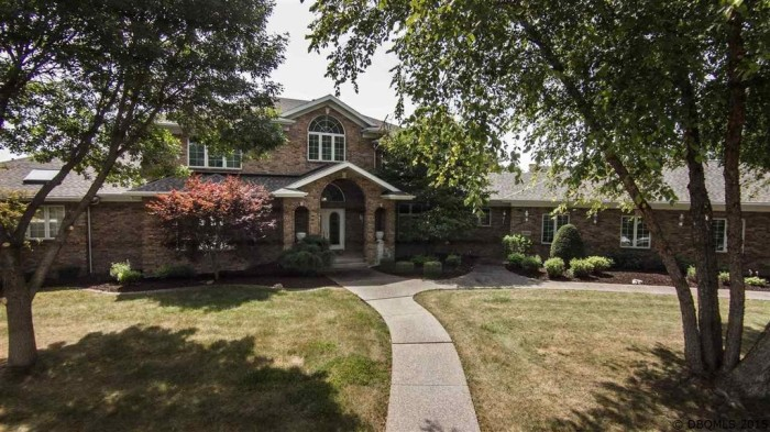 5. For $699,000, you could own this 6 bedroom 9 bathroom mansion in Dubuque. This stunning property offers 8,315 sqft living space, a fitness room, rec room, wet bar, wine cellar, and spacious outdoor deck with a fire pit.