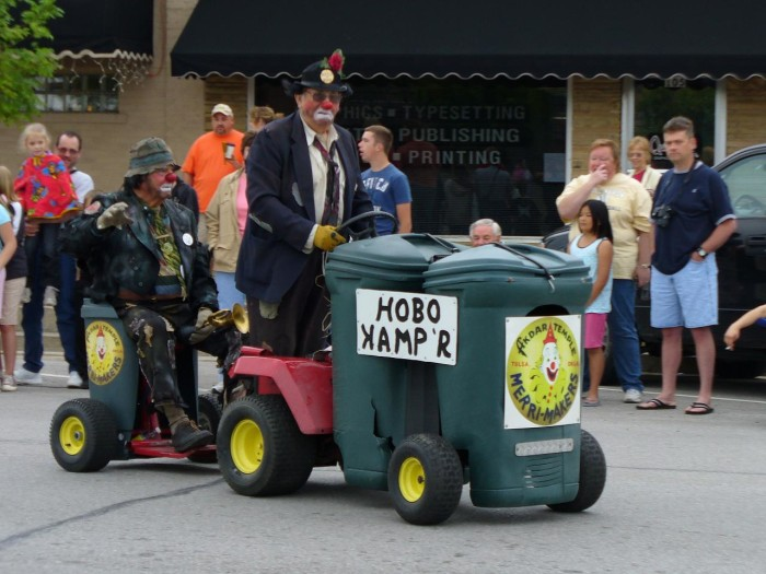 3. A hobo kamp'r just strolling down the street. Good thing it's in a parade or we would really be embarrassed.