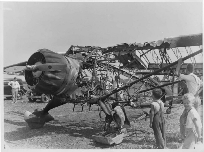 6. People examine Stinson plane destroyed by fire at Springfield Airport (1934)
