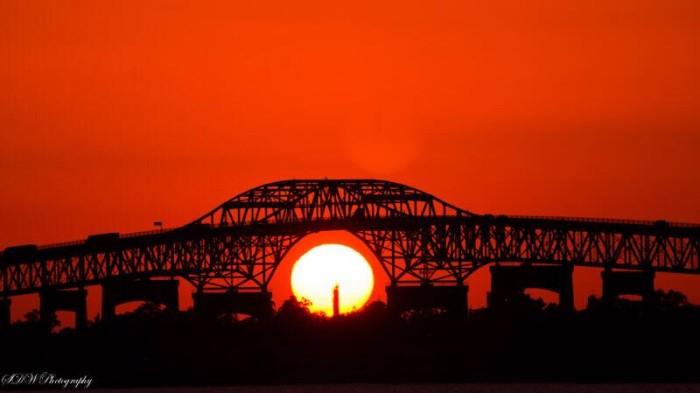 15) Setting sun perfectly framed by bridge.